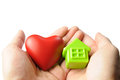Love and home holding red heart green house in hand give family concept Stock Image