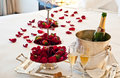 Love honeymoon suite with chocolate strawberries and an opened bottle of champagne Royalty Free Stock Photos