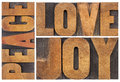 Love joy and peace typography abstract a collage of isolated words in letterpress wood type Royalty Free Stock Images