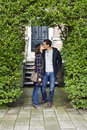 Love kissing couple embracing outdoor looking happy portrait of Royalty Free Stock Images