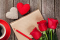 Love letter notepad, red roses and coffee cup Royalty Free Stock Photo