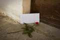Love letter and red rose in vase in front of doorway concept Royalty Free Stock Images