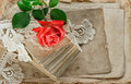 Love letters red rose flower. Papers and lace Royalty Free Stock Photo
