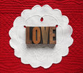 Love on linen doily Royalty Free Stock Photo