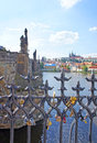 Love locks hang from on the charles bridge in prague european custom for newlyweds secure friendship and romance Royalty Free Stock Photography