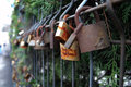 Love locks its key is thrown away to symbolise unbreakable Stock Image