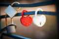 Love locks red and white lock as a symbol of relationship faithfulness Royalty Free Stock Image