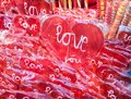 Love lollipops red heart shaped with Royalty Free Stock Photography