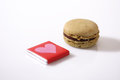 Love macaron and a piece of choc heart shape Stock Image