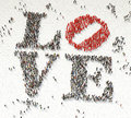Love made from crowd aerial view of text written out of people on white background Royalty Free Stock Images