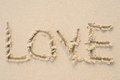 Love message written in sand. Beach background. Royalty Free Stock Photo