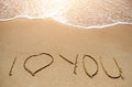 Love message written on the sand beach Royalty Free Stock Photo