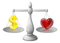 Love or money scales with a dollar sign on one side and a heart on the other Stock Photo