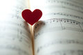 Love for music heart shape on a note book shallow dof Royalty Free Stock Photos