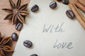 With love note and spices, sticks of cinnamon and anise star on wooden background.