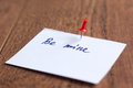 Love note on the white sticker paper on the wooden desk Royalty Free Stock Photography