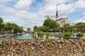 Love padlocks at bridge over river Seine in Paris, France Royalty Free Stock Photo