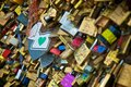 Love padlocks in a bridge over the seine river in paris france Royalty Free Stock Image