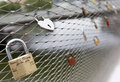 Love padlocks locks message of on a locked to a bridge fence in vienna austria Royalty Free Stock Image