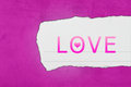Love with paper tears on pink texture Royalty Free Stock Image