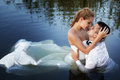 Love and passion - kiss of married couple in water Royalty Free Stock Photo