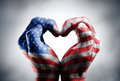 Love and patriotism symbols usa flag on hands Royalty Free Stock Image