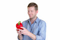 Love peppers man holding a big red bell pepper Royalty Free Stock Photos