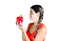 Love peppers young woman looking at a big red bell pepper Stock Photo