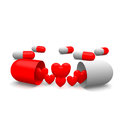 Love pills heart symbol around of Royalty Free Stock Photography