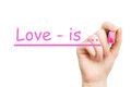 Love is pink marker on white background Royalty Free Stock Photography