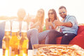We love pizza and beer! Royalty Free Stock Photo
