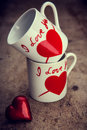 Love red heart and mug on wooden background valentines day background Stock Images