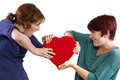 Love rivals two friends become on valentines day fighting over a heart Stock Photo