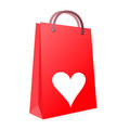 Love shopping an image for the concept of till you drop the image shows a red carrier bag with a heart symbol on it and Royalty Free Stock Images