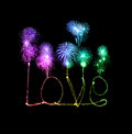 Love sparkler firework light alphabet with fireworks Royalty Free Stock Photo