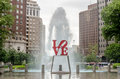 Love statue in philadelphia with scenic fountain against a cloudy sky Royalty Free Stock Images