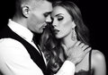 Love story beatiful sexy couple gorgeous blond woman and handsome man fashion black white studio photo of beautiful in elegant Royalty Free Stock Photo