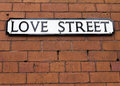 Love street sign on a red brick wall Royalty Free Stock Image
