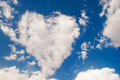 Love symbol cloud shaped on sky background Stock Photos