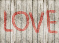 Love symbol and word love on wooden floor wood plank Stock Photos