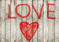 Love symbol and word love on wooden floor wood plank Royalty Free Stock Photo
