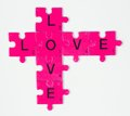 Love tag pink puzzle pieces showing word Stock Photos