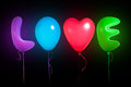 Love text shaped color balloons black background Stock Photography