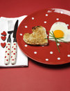 Love theme Valentine breakfast on red polka dot plate, vertical Stock Photography