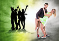 We love to dance all time dancing teen couple on bright grunge background Stock Images