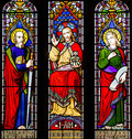 Love truth faith hope stained glass window part of a depicting jesus christ st paul st john and the concepts of and Stock Image