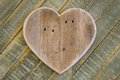 Love Valentines wooden heart on light green painted background Royalty Free Stock Photo