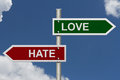 Love versus hate red and green street signs with blue sky with words and Royalty Free Stock Photography