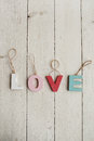 Love vintage letters on wooden background Royalty Free Stock Photo