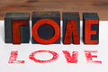 Love in wooden letterpress Stock Images